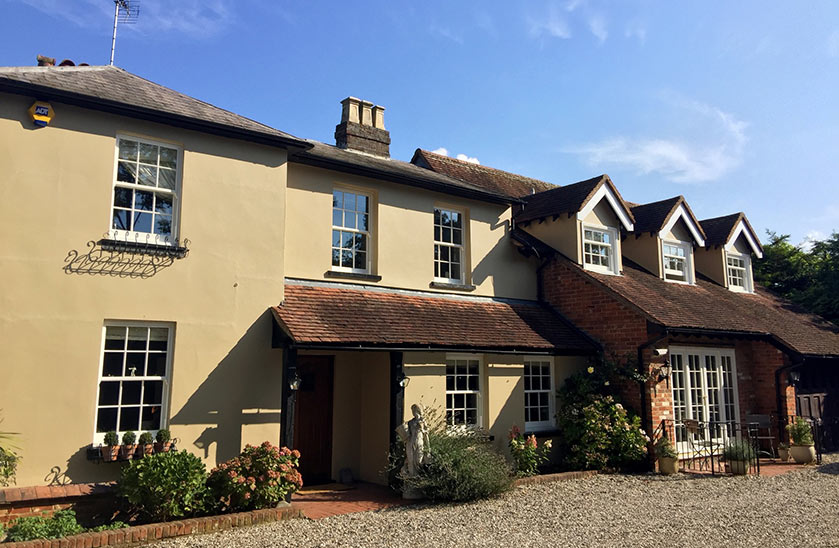 Essex cottage style house with timber alternative sash windows