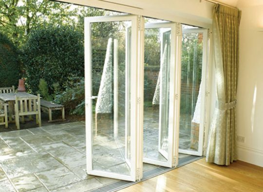 BF Sunflex slim aluminium frame bifold door bringing the home and garden together