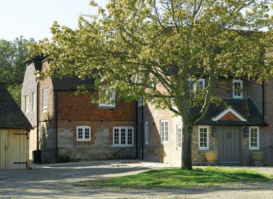 FC Old Essex farmhouse with traditional design flush casement timber windows and bespoke entrance door