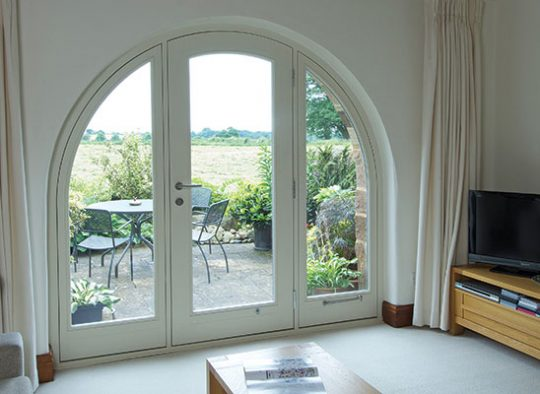 FD Arched headed French window providing perfect panorama