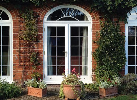 FD Charming felixstowe property with arched headed timber French doors including sunburst astragal bar effect