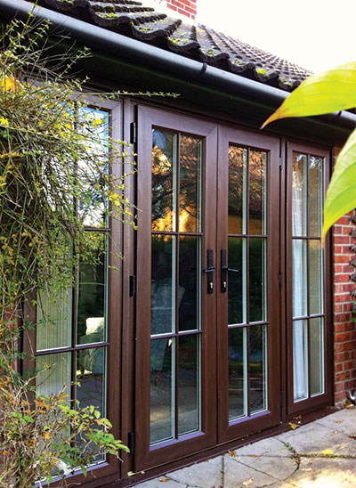 FD Timber alternative French doors manufactured by Evolution. Natural wood finish with wrought iron handles
