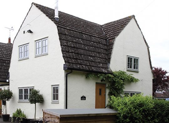 L Essex cottage with engineered redwood frames French grey finish with crucifix astragal bar detail