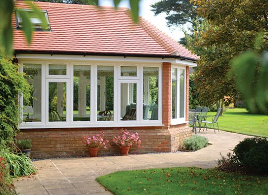 L Garden room with meranti hardwood lipped casements in white finish